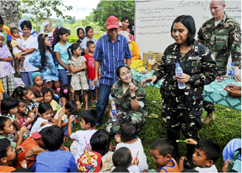 A dental technician teach dental hygiene to local children and their families during a medical and dental civic action project. © Mass Communication Specialist (AW) 2nd Class Joshua Scott/Released