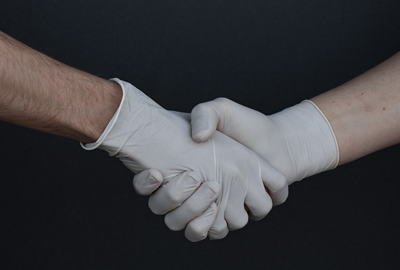 Handshake in gloves: Unsplash