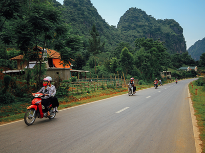 Motorcycles on rural road, Vietnam. © Adam Cohn